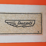 Natural stone mosaic of the Ducati brand, prestigious object for the home, the office, the workshop.